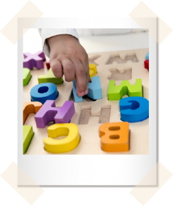 Kid playing with alphabet puzzle